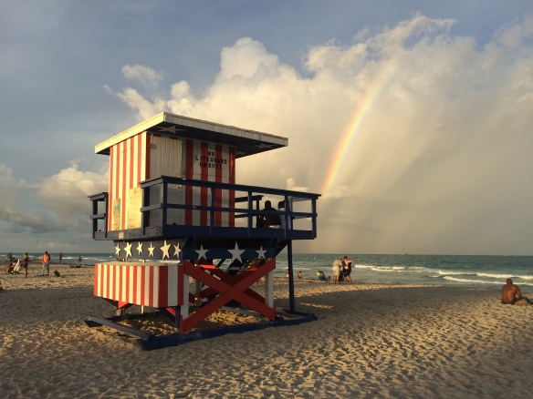 Rainbow over the lifeguard huts on Miami beach